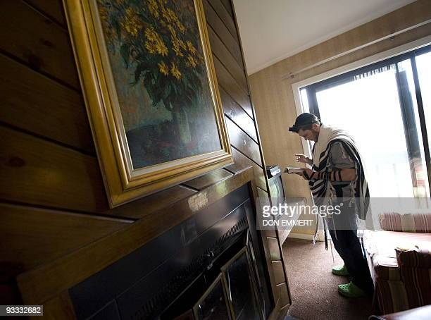 Light-welterweight number one boxing contender Dmitriy Salita prays in his room November 12, 2009 in Bushkill, Pennsylvania. Salita, an Orthodox Jew...