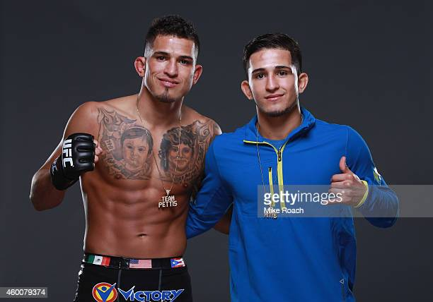 Lighweight champion Anthony 'Showtime' Pettis poses with brother Sergio Pettis backstage for a post fight portrait during the UFC 181 event inside...