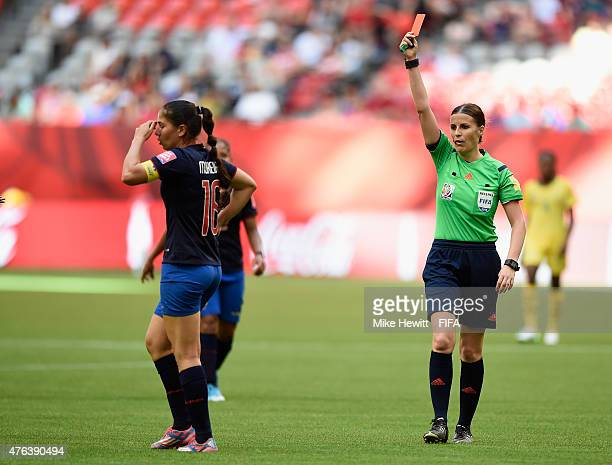 Ligia Moreira of Ecuador receives a red card from referee Katalin Kulcsar for a foul on Gaelle Enganamouit of Cameroon during the FIFA Women's World...