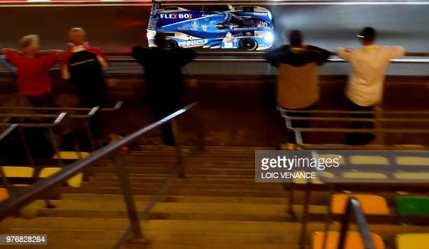 Ligier JSP217 Gibson Korean driver Tacksung Kim competes during the 86th Le Mans 24hours endurance race at the Circuit de la Sarthe at night on June...