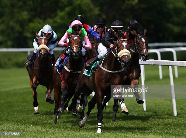 Lignon's Hero ridden by Liam Jones leads the field in the Preis der Lotterie Super 6 during the Lotto Festival 2013 at Galopp Munich on June 9 2013...