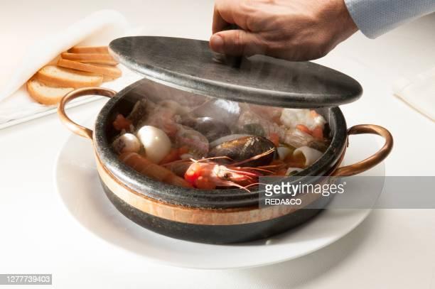 Ligurian sea fish soup in soapstone, Claudio Ristorante, Bergeggi, Liguria, Italy, Europe.