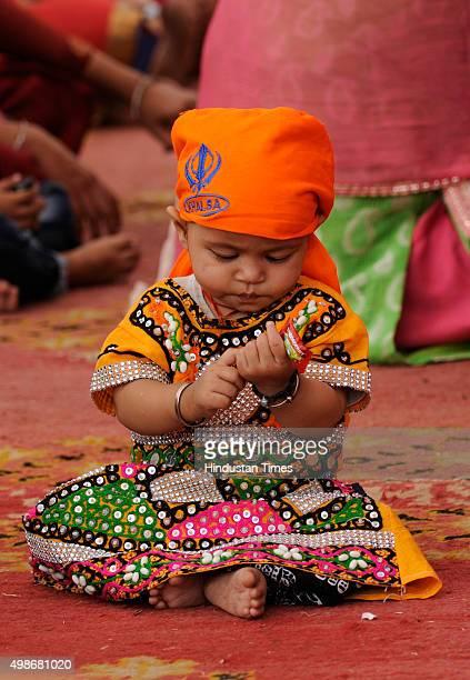 Liitle devotee on the birth anniversary of Guru Nanak Dev at Gurudwara, on November 25, 2015 in Noida, India. Guru Nanak's Prakash Utsav and Guru...