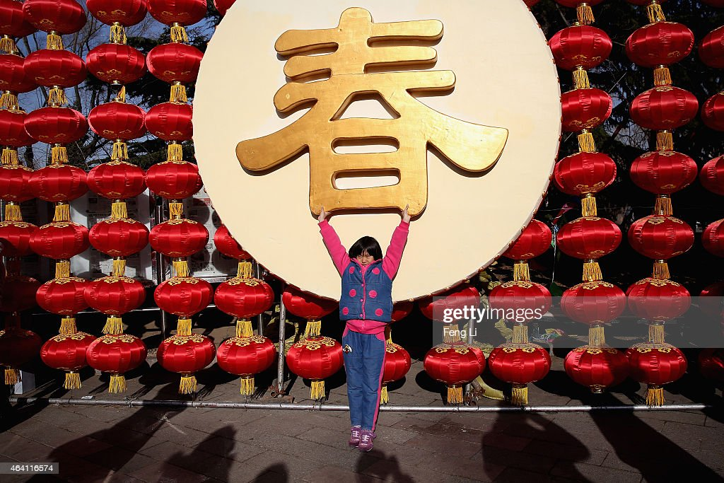A liitle girl poses for photos as she and her family visit a temple fair to celebrate the Lunar New Year of Sheep during serious pollution on February 22, 2015 in Beijing, China. The Chinese Lunar New Year of Sheep also known as the Spring Festival, which is based on the Lunisolar Chinese calendar, is celebrated from the first day of the first month of the lunar year and ends with Lantern Festival on the Fifteenth day.
