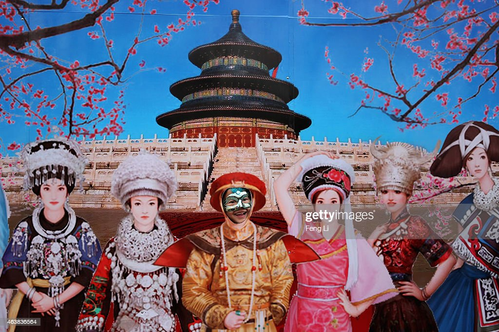A liitle girl wearing the mask poses for photos at a temple fair to celebrate the Lunar New Year of Sheep on February 19, 2015 in Beijing, China. The Chinese Lunar New Year of Sheep also known as the Spring Festival, which is based on the Lunisolar Chinese calendar, is celebrated from the first day of the first month of the lunar year and ends with Lantern Festival on the Fifteenth day.