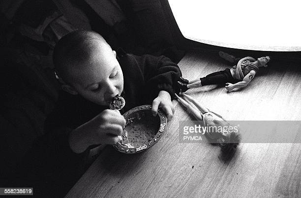 Liitle kid eating a bowl of cereal Newport South Wales