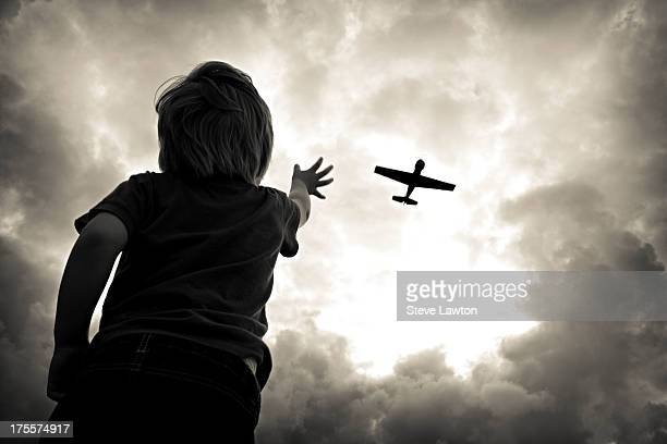 a liittle boys dream - military airplane stock pictures, royalty-free photos & images