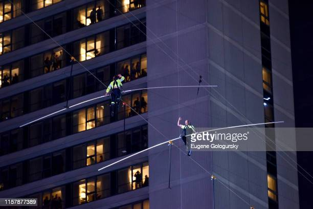 Lijana Wallenda and Nik Wallenda walk a high wire over Times Square during the Highwire Live In Times Square With Nik Wallenda on June 23 2019 in New...