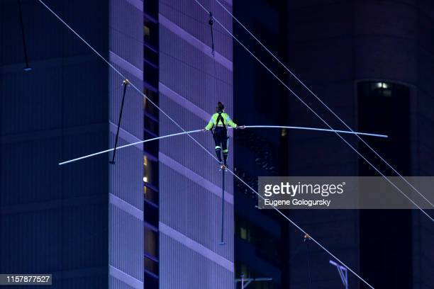 Lijana Wallenda walks a high wire over Times Square during the Highwire Live In Times Square With Nik Wallenda on June 23 2019 in New York City