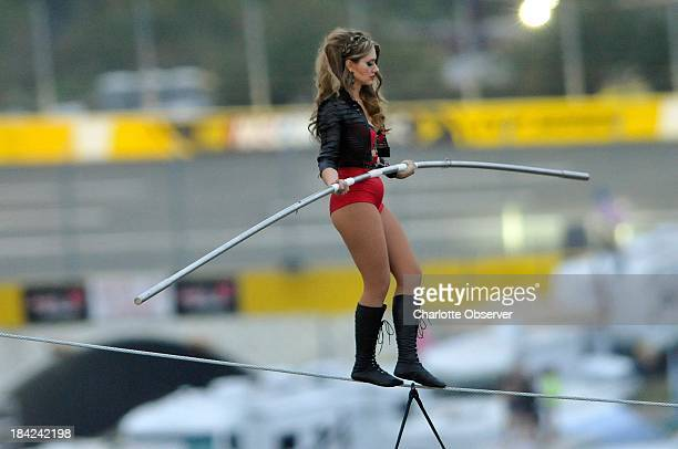 Lijana Wallenda walks the tightrope above Charlotte Motor Speedway on Saturday October 12 with her brother Nik 140 feet above pit road during the...