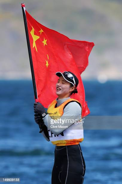 Lijia Xu of China celebrates winning gold in the Laser Radial Women's Sailing on Day 10 of the London 2012 Olympic Games at the Weymouth Portland...