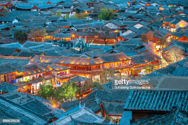 Lijiang Old Town bird eye top top view with local historical architectures roof building in night scene