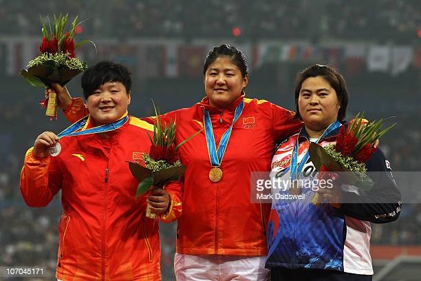 Lijiao Gong of China winner of the silver medal Ling Li of China winner of the gold medal and Mi Young Lee of South Korea winner of the bronze medal...
