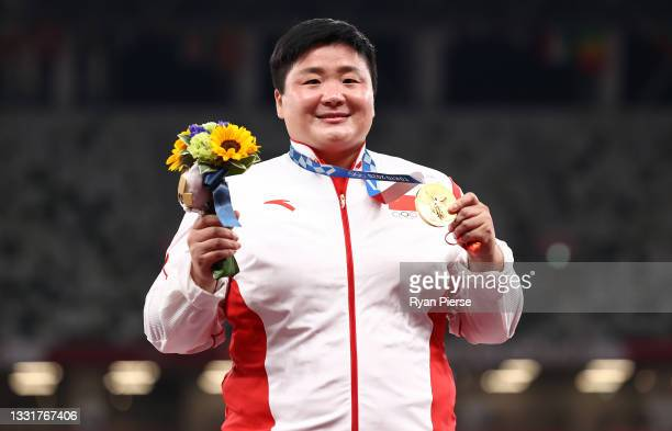 Lijiao Gong of Team China celebrates with the gold medal during the medal ceremony for the Women's Shot Put on day nine of the Tokyo 2020 Olympic...