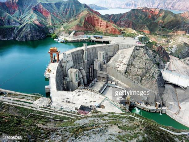 """lijiaxia reservoir in kanbula national forest park, entitled """"small gulin in qinghai"""", is the most famous scenery in jianzha county, huangnan tibetan autonomous prefecture in qinghai province, china. - dam china stock pictures, royalty-free photos & images"""