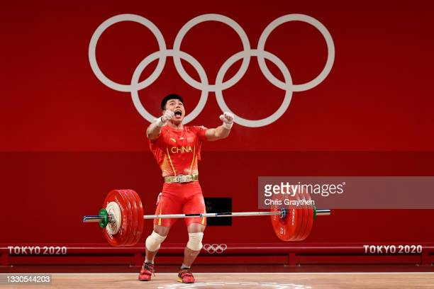 Lijun Chen of Team China competes during the Weightlifting - Men's 67kg Group A on day two of the Tokyo 2020 Olympic Games at Tokyo International...
