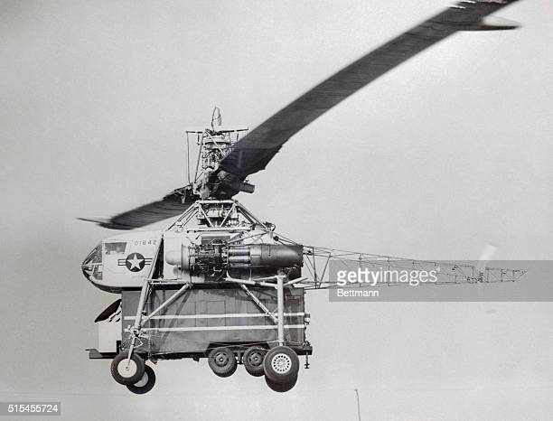 Like a giant dragonfly the world's largest helicopter easily lifts a big Air Force van as it completes flight tests at Los Angeles The powerful XH17...