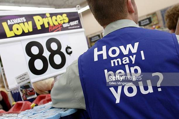 Like all his colleagues in the company's 5307 stores a Bentonville WalMart employee wears the company's customer service slogan on his jacket March...