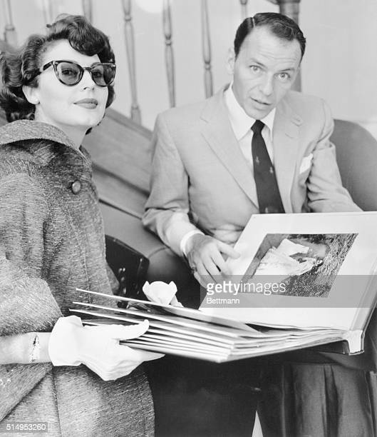 Like any other good wife actress Ava Gardner waits for the word from husband Frank Sinatra before choosing a new dress at a Roman fashion salon Miss...