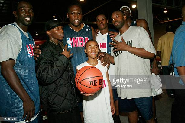 Like Mike star Lil Bow Wow with NBA players Elton Brand Michael Finley Quentin Richardson Darius Miles and Baron Davis at Gaucho's Gym in the Bronx...