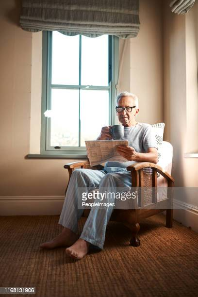 i like my news the old fashioned way - fragility stock pictures, royalty-free photos & images
