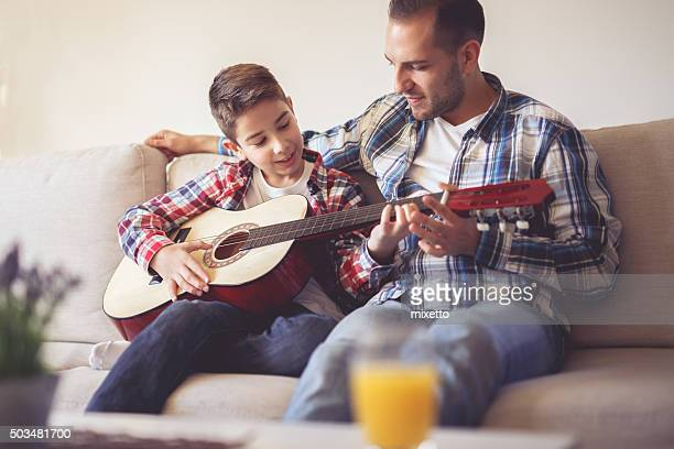 like to play guitar - plucking an instrument stock pictures, royalty-free photos & images
