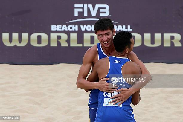 Likejiang Ha and Jian Bao of China celebrate for the point on Day 2 at the 2014 FIVB Beach Volleyball World Tour Xiamen Open men's main draw match on...