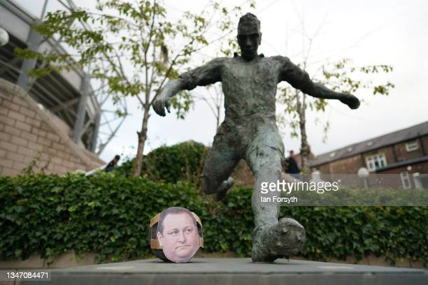 Likeness of former Newcastle owner Mike Ashley is placed on the statue of Jackie Milburn as Newcastle United play their first game after the club's...