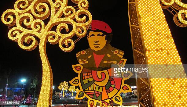 A likeness of former Venezuelan leader Hugo Chavez illuminates a nighttime boulevard of the Nicaraguan capital of Managua that is lined with what the...
