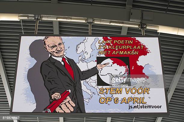 A likeness of Russian President Vladimir Putin standing beside a map of Europe and Russia sits on a vote 'Yes' campaign poster of the Young...