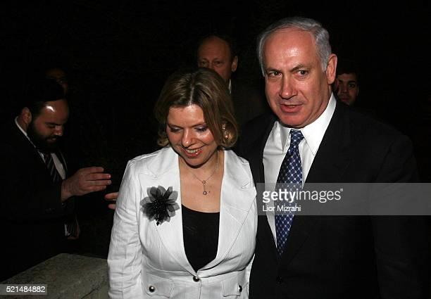 Likud leadership candidate Benjamin Netanyahu and his wife Sara leaving there house in Jerusalem Monday, December 19, 2005. Benjamin Netanyahu on...