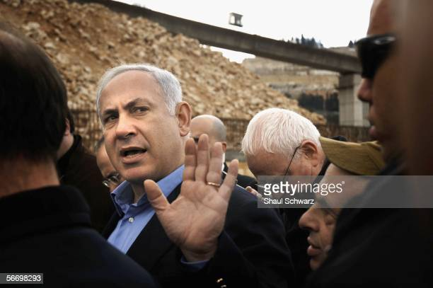 Likud Party Chairman Benjamin Netanyahu and other members of his party including former Israeli Foreign Minster Silvan Shalom take a tour on January...