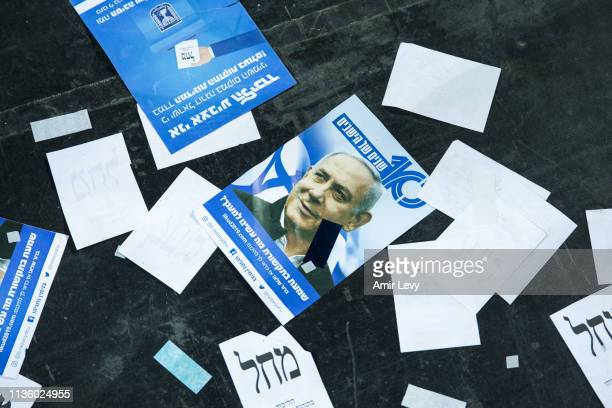 A likud party note with the photo of Israel's Prime Minster Benjamin Netanyahu is left on the floor after an after vote event on April 10 2019 in Tel...