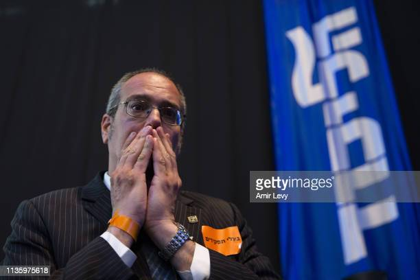 Likud party supporter reacts to exit polls in the party headquarters in Tel Aviv on April 9, 2019 in Tel Aviv, Israel. Prime Minister Benjamin...