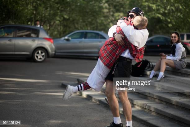 Likuna Khachapuridze hugs a friend on May 3 2018 in Tbilisi Georgia