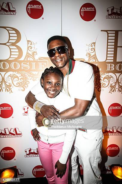 Lil Boosie hugs his daughter The LIL Boosie press conference at W Hotel New Orleans on March 10 2014 in New Orleans Louisiana