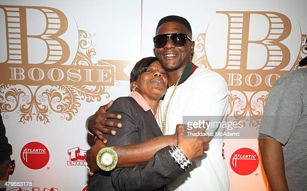 Lil Boosie Hugs his mother on the step and repeat The LIL Boosie press conference at W Hotel New Orleans on March 10 2014 in New Orleans Louisiana