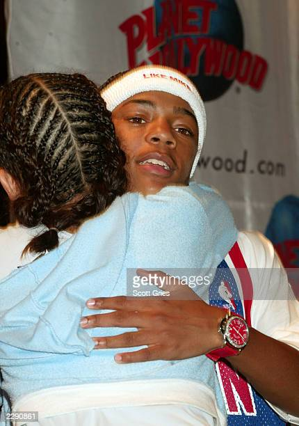 Lil' Bow Wow hugs a fan during an appearance to promote his new movie 'Like Mike' at Planet Hollywood in New York City 7/1/02 Photo by Scott...