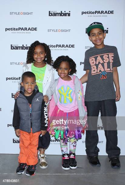 Lil' C Jaden Cyia and Carter Sabathia pose in CCandy Clothing seen at the Petite Parade Kids Fashion Show at 545 West 22nd Street on March 8 2014 in...