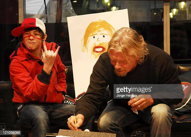 Lil Chris and Richard Branson during Virgin Media Photocall at Covent Garden in London Great Britain