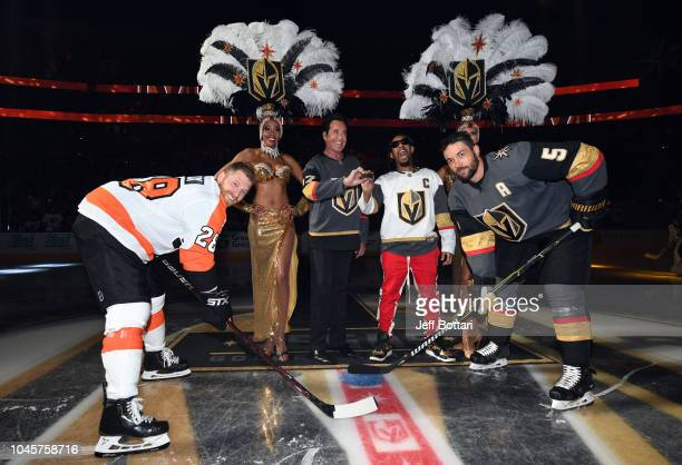 Lil Jon and Wayne Newton perform the ceremonial puck drop prior to the game between the Vegas Golden Knights and Philadelphia Flyers at TMobile Arena...