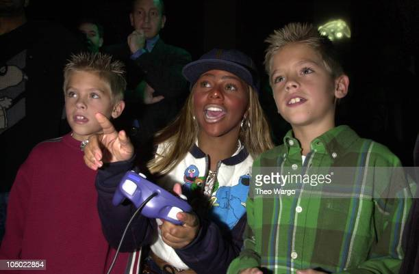 Lil' Kim and Cole Sprouse and Dylan Sprouse playing Nintendo