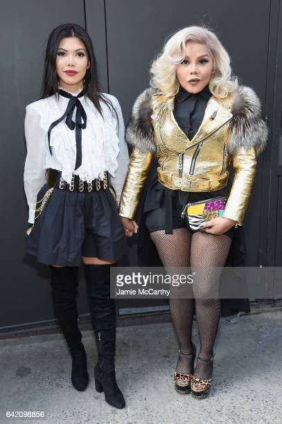Lil' Kim and guest attends the Marc Jacobs Fall 2017 Show at Park Avenue Armory on February 16, 2017 in New York City.