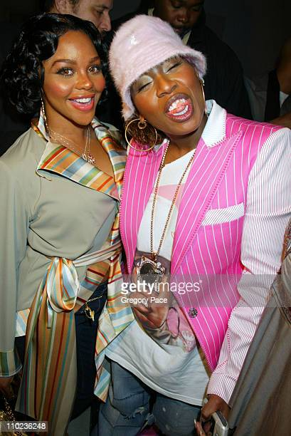 Lil Kim and Missy Elliot during Olympus Fashion Week Fall 2005 Baby Phat Front Row and Backstage at Skylight Studios in New York City New York United...