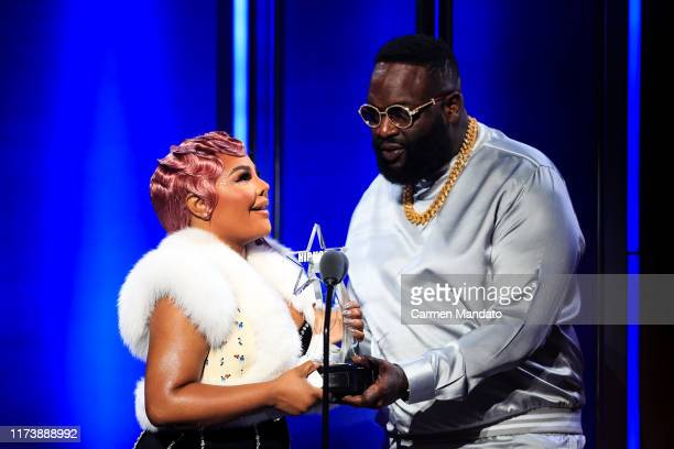 LIl' Kim and Rick Ross embrace onstage at the BET Hip Hop Awards 2019 at Cobb Energy Center on October 5 2019 in Atlanta Georgia