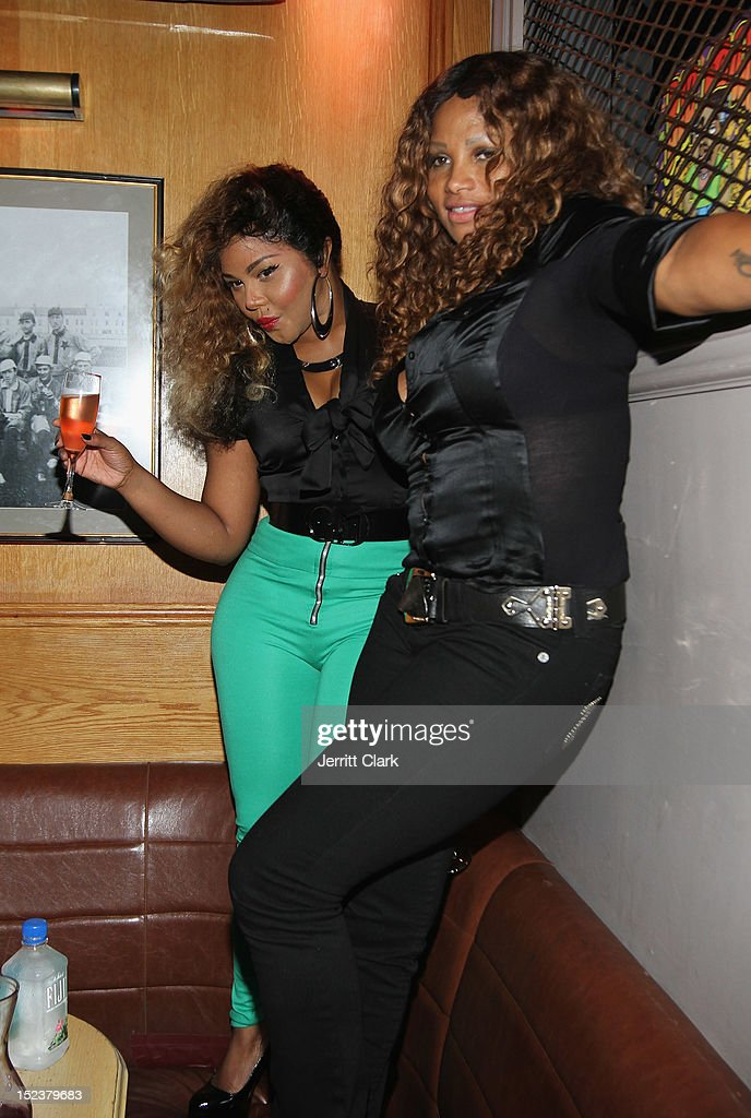 Lil Kim and Sandra 'Pepa' Denton attend the 1 year anniversary party at Bounce Sporting Club on September 19, 2012 in New York City.