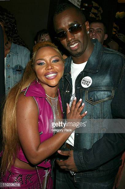 Lil' Kim and Sean 'P Diddy' Combs during Olympus Fashion Week Spring 2005 Sean John Store Opening Party at Sean John Store 5th Avenue in New York...