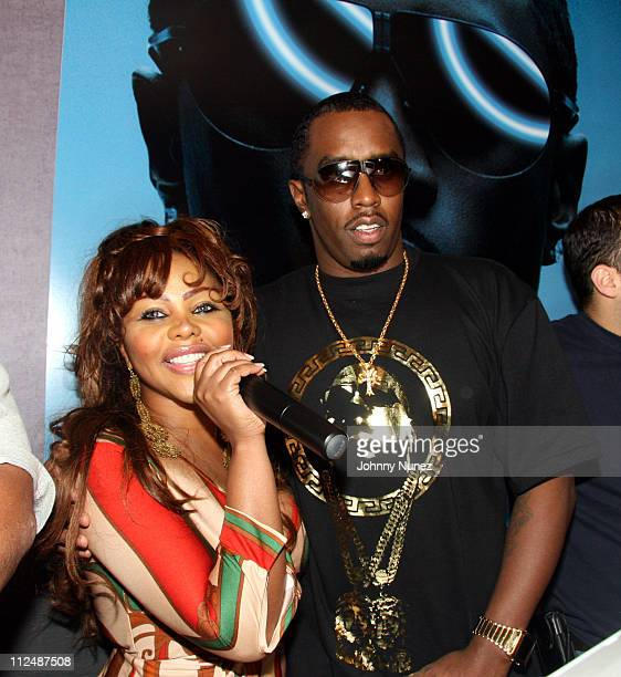 Lil Kim and Sean P Diddy Combs during Sean Diddy Combs Press Play CD Listening Party and Andre Harrell Birthday Party September 25 2006 at Tenjune in...