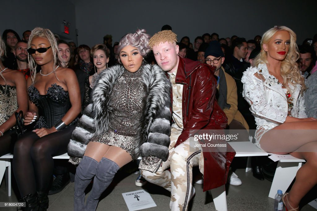 Lil Kim and Shaun Ross attend the front row during New York Fashion Week: The Shows at Gallery I at Spring Studios on February 13, 2018 in New York City.