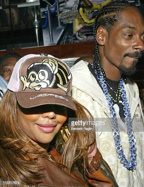 """Lil Kim and Snoop Dogg during Snoop Dogg's """"Tha Blue Carpet Treatment"""" Album Preview Party at Strata Night Club in New York City, New York, United..."""